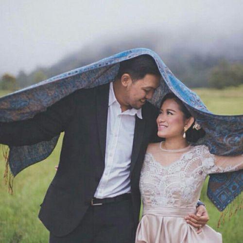 Foto fotografi pernikahan oleh Maknafoto