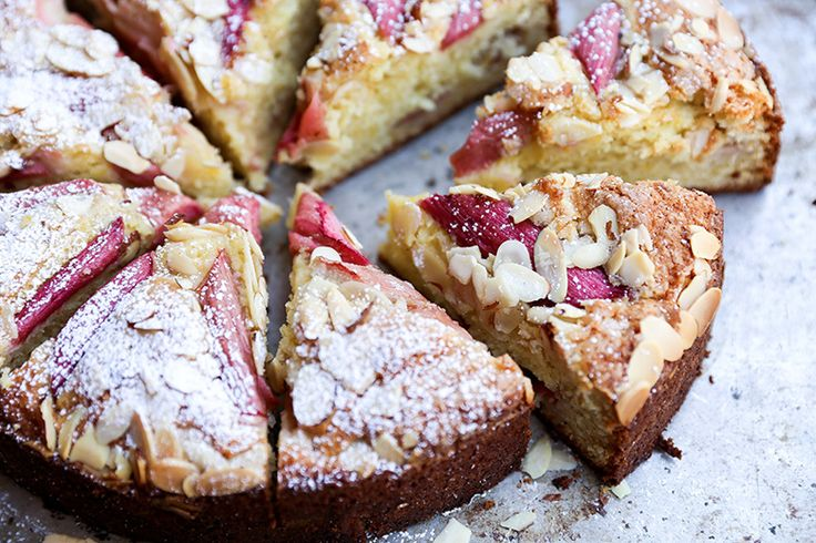 Rhubarb-Almond Cake (for 10 in springform pan: 1 cup sugar, 1 stick butter, 1 cup Greek Yogurt, orange zest, vanilla and almond extract, 1 1/2 cup flour, 1/2 cup almond meal, cardamom, .75 lbs rhubarb, almonds...)