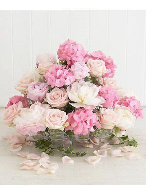 DIY Cupcake Stand Flower Arrangement. Great for a centerpiece :o)