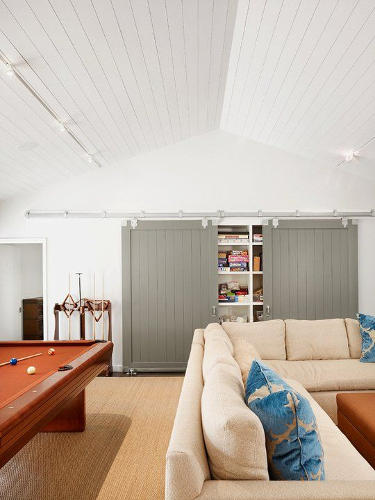 ... Fantastic Vaulted Ceiling With White Wood Boards. Sliding Barn Doors In  Warm Gray. Natural Fiber Area Rug, Biege Sectional And Snooker/pool Table.