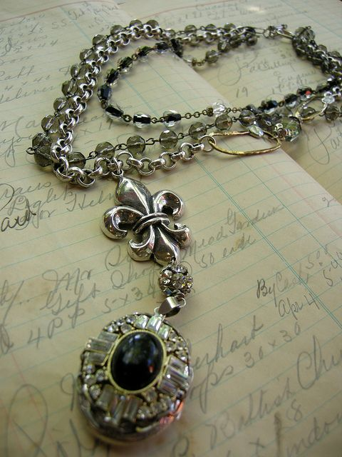 "French Nuance    French Nuance Choker (19""): antique sterling silver locket; vintage rhinestone and onyx earring; sterling silver fleur de lis; silver chain; topaz; handmade brass chain links; antique rosary chain beads; sterling silver clasp. #200240"