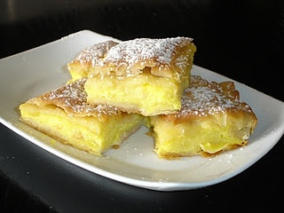 This is a recipe for Bougatsa (pronounced with a soft g) which is yet another delicious sweet. People often buy these from small shops on the street and eat them as they are walking. The quality in these shops varies, as you can imagine, but the recipe below will produce a tasty pastry and delicious filling.