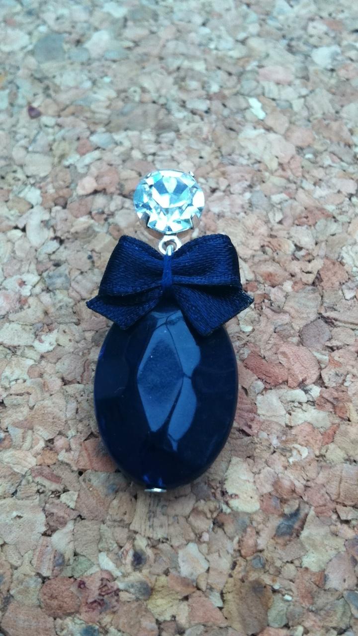 Blauwe strik met blauwe facet steen