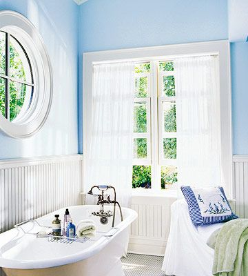 A limited palette of colors and materials adds serenity to a bath. Windows allow sun to pour in. Wrap the walls in beaded-board paneling.