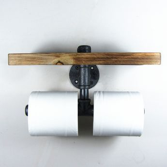 Add a little Industrial/Urban chic to your bathroom Combining a handy wooden shelf and using iron pipes to make the sturdy double roll holder.