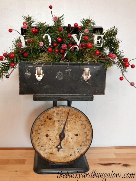 Vintage Lunch Box...stuffed with pine & berries... thebackyardbungalow.com.