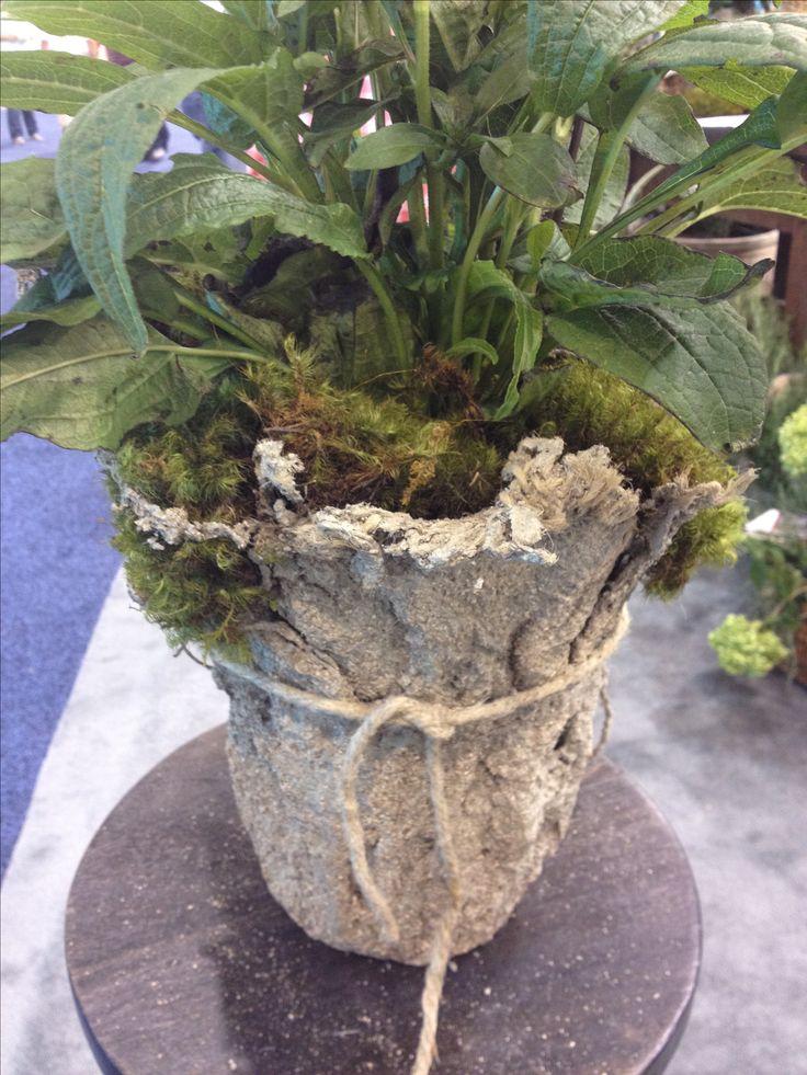 Light weight hypertufa. Dip burlap in hypertufa mix, shape over upside down pot, then let it harden.