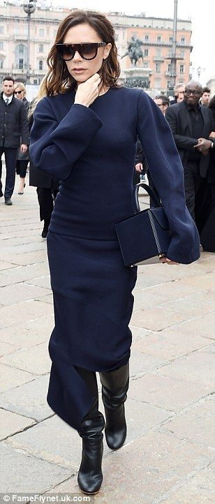 Making an appearance: 42-year-old Victoria wore a conservative navy deconstructed dress an...