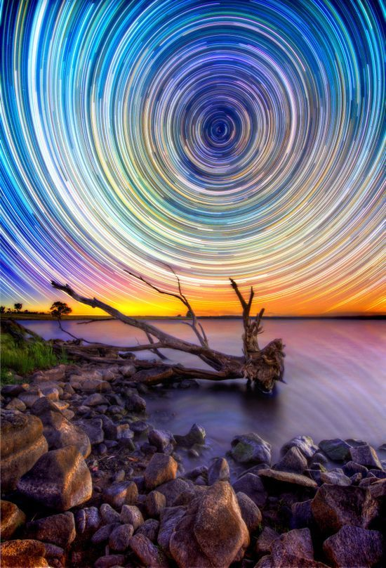 Lincoln Harrison's Australian Outback Night Sky Pictures Dazzle.  At first glance these pictures look like something that greets you at the end of a kaleidoscope. But these marvels are the product of up to 15 hours of shooting the stars in the Aussie outback. The swirling spectacles were snapped using long exposure lenses on a Nikon D7000 and a Nikon D3100