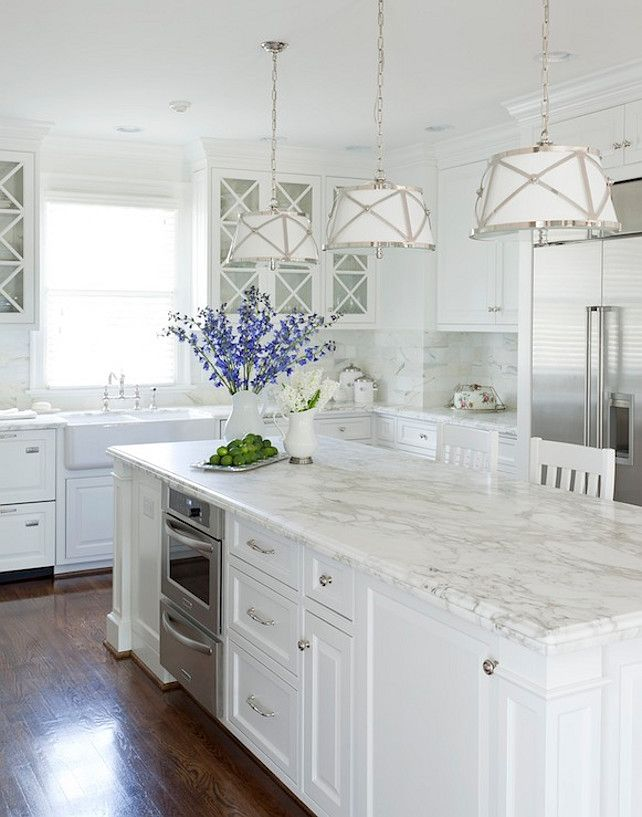 Kitchens   Kitchen Cabinets Kitchen Island Farmhouse Sink Calcutta Gold  Marble Countertops Backsplash Wood Panel Stacked Dishwashers Warming  Drawers ...