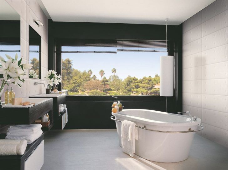 Robert Castellano built this modern bathroom with black wall around window and textured white tiles on opposite wall