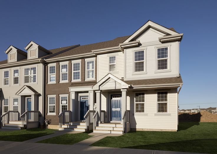 An exterior shot of our Chappelle Gardens town houses, featuring our new Avanti show home.