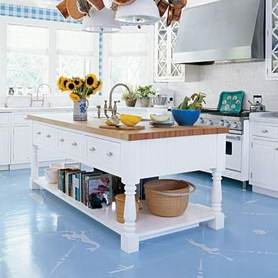Coastal motifs stenciled onto painted wood floors add a playful touch and take a traditional blue-and-white scheme to a whole new level. coastalliving.com