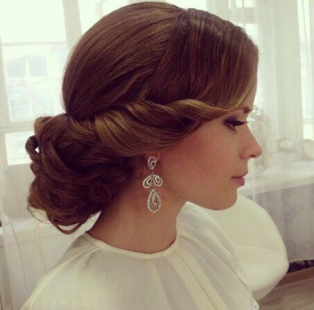 Elegant wedding hair. And don't forget her beautiful earrings