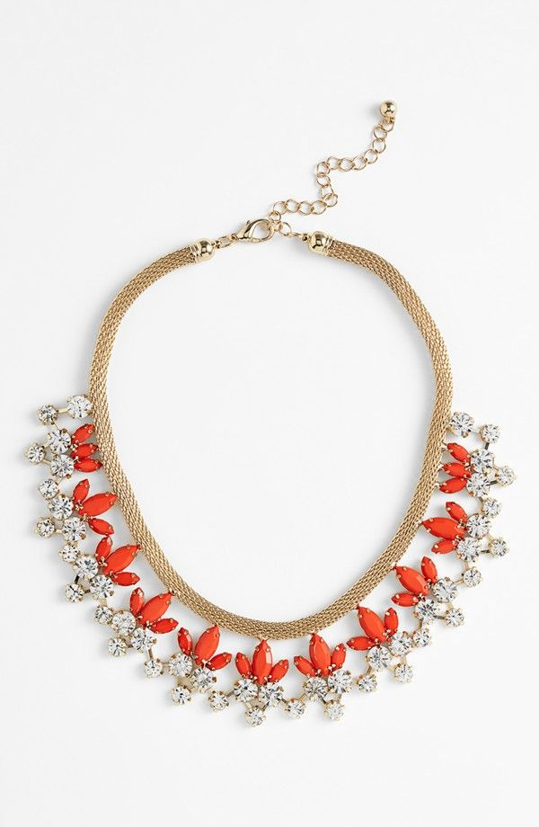 Adding this sparkly coral and clear crystal necklace to the jewelry box.