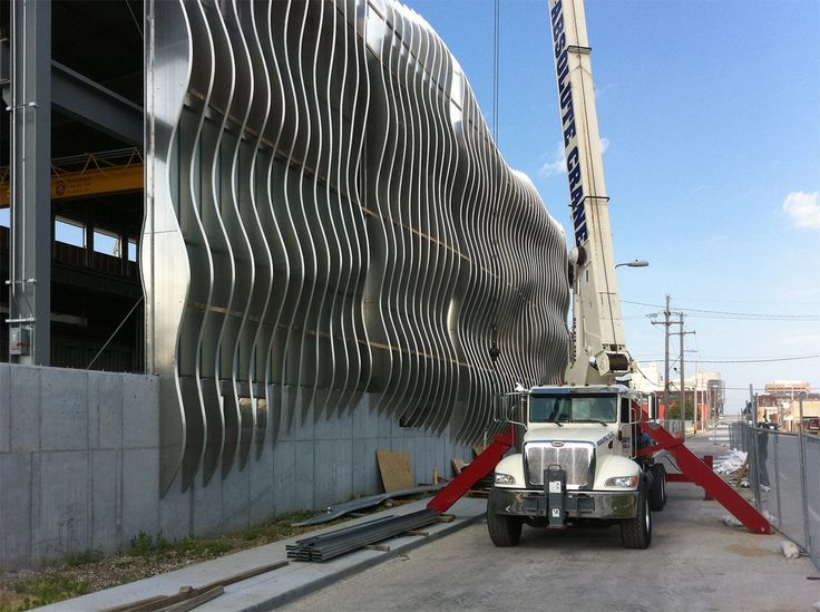 Great screen wall that does not compromise the building envelope... Zahner