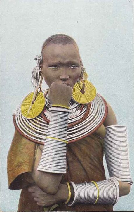 "Africa | ""A Masai woman decorated with spirals and bracelets made of brass, iron and copper wire. Mount Meru, German East Africa."" 