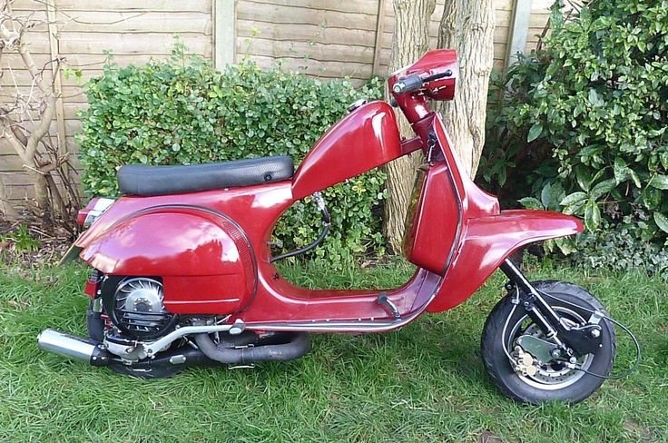 http://www.ebay.co.uk/itm/Vespa-Piaggio-Scooter-Custom-Cut-Down-Chop-PX-PX125-210-Malossi-Candy-Red-/231505548000