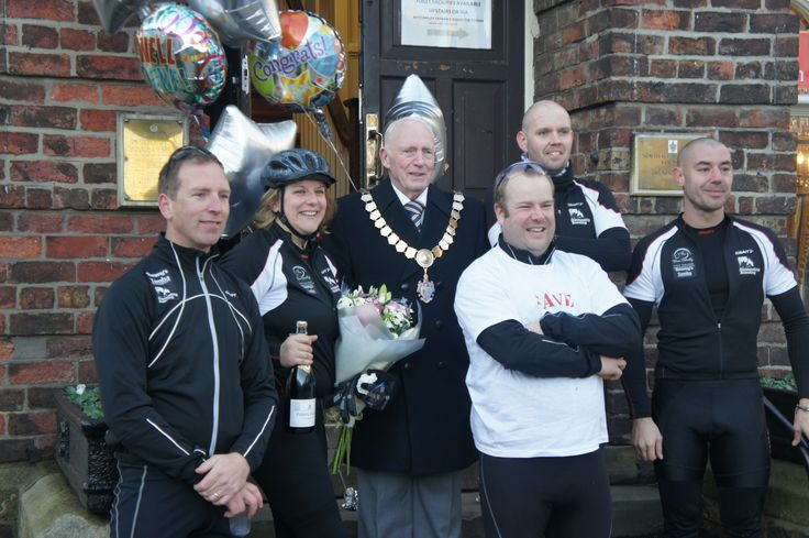 Beth and Steve Morris with the Born Silently Cycle Challenge team at the finishing line in Northallerton
