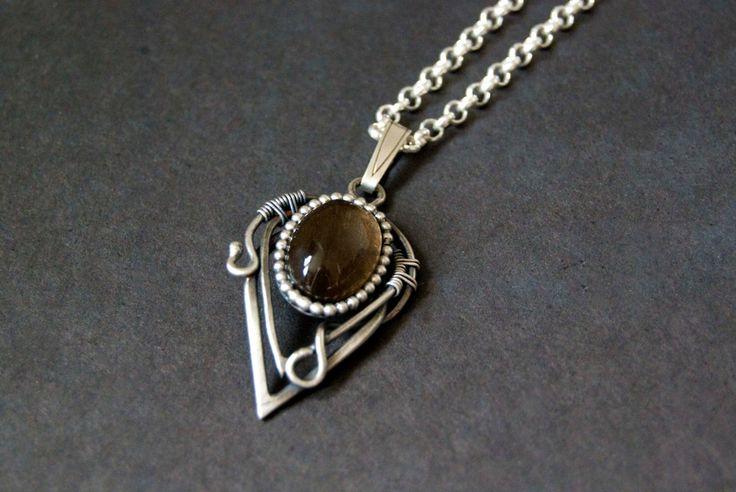 Smokey Quartz pendant, sterling silver, wire wrapped, oxidized handmade pendant, brown gemstone  by Draadjuwelen on Etsy https://www.etsy.com/listing/164894040/smokey-quartz-pendant-sterling-silver