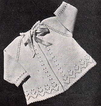 raglan baby jacket with picot edging, long sleeves and lace patterning.