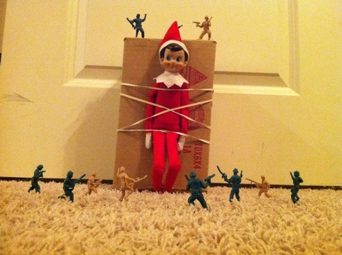 Elf Held Hostage By Army Men Elf Ideas Xmas Elf