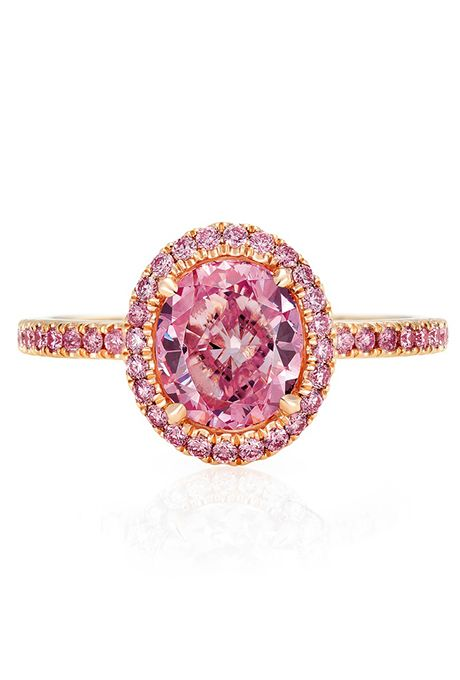 A pink oval-cut diamond engagement ring with a pink diamond pavé set in rose gold by @debeersofficial | Brides.com