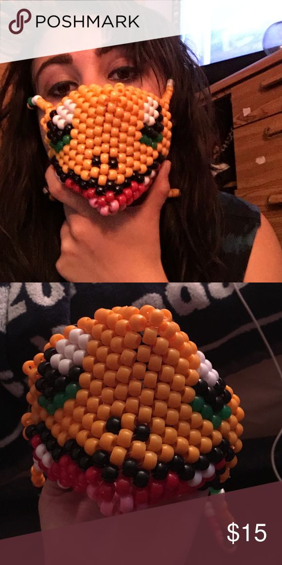 Pokemon Kandi mask rave Charmander? I'm pretty sure that's the right Pokemon, if not, forgive me for I am not knowledgeable of Pokemon. Handmade. Not stretchy. Materials: beads and fishing line.  Can do custom/ requested masks. Kind of bigger than the rest *sorry about the wrong name* Pokemon Other