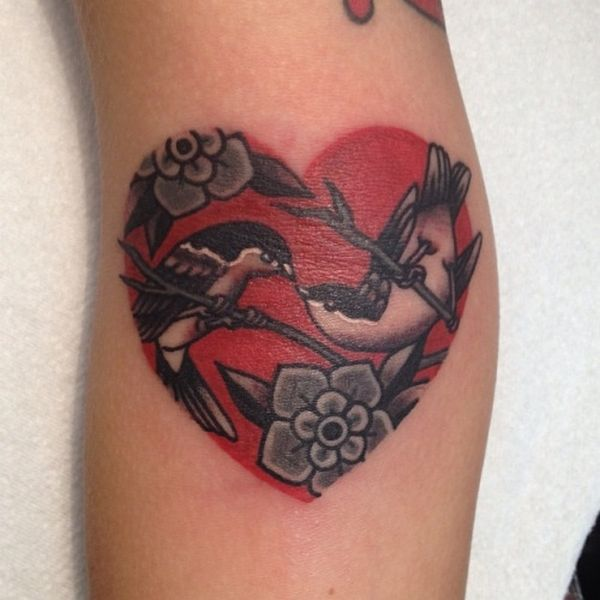 Love birds and heart tattoo - Traditional tattoos are great for bird designs. #TattooModels #tattoo
