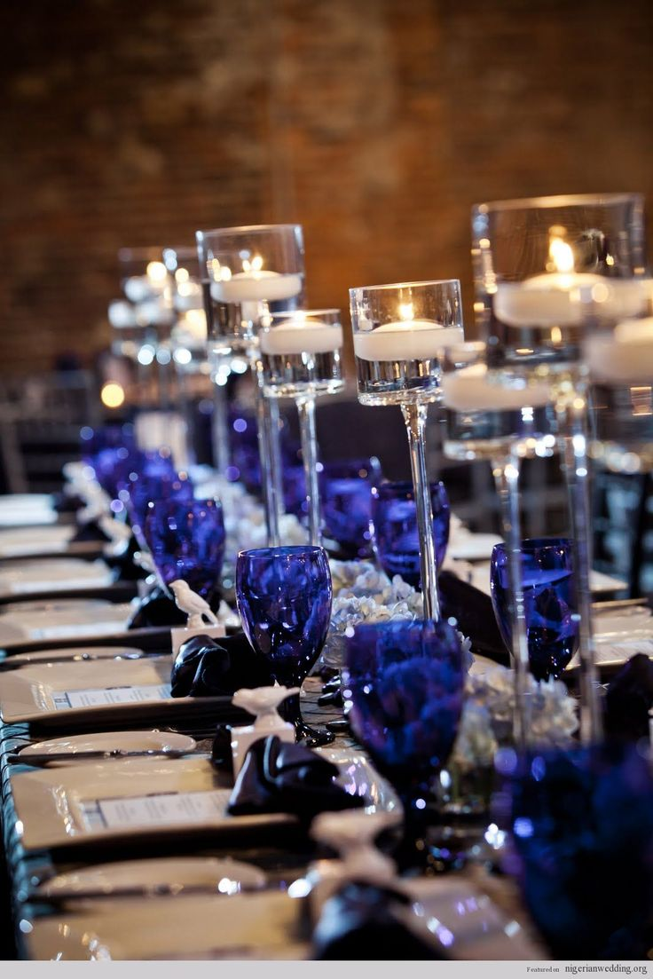 Great way to add a dash of color - cobalt blue water glasses for wedding table setting - love the reflection