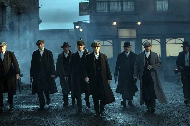 I wish I had friends that would dress like this, then we could parade around in the fog with ominous music.