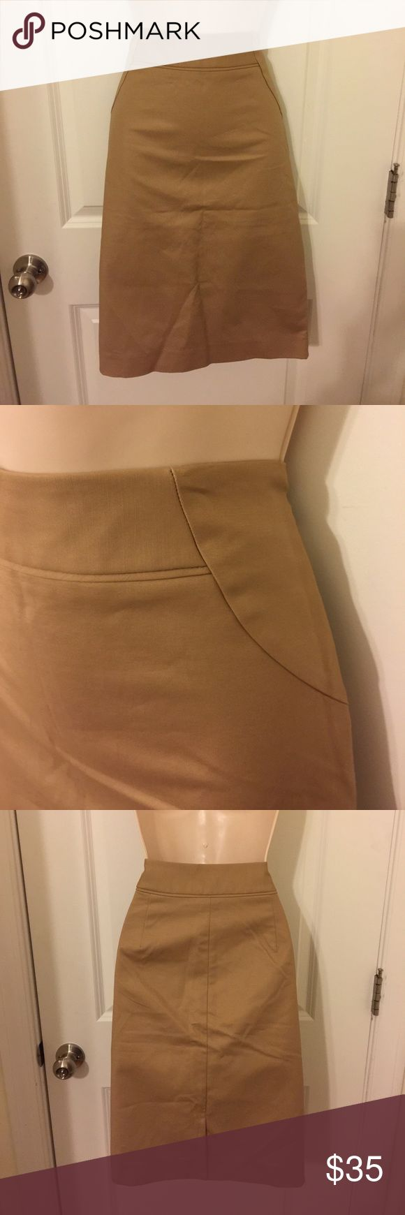 "NWT tan Pencil/straight skirt THE LIMITED sz 8T NEW WITH TAGS!! Tan colored pencil skirt from THE LIMITED  Size 8T TALL Waist: 31"" Hips: 38"" Length (waist to hem): 23"" With side hook and zip fastening. 2"" waistband. Fully lined. 5"" slit at back, still factory stitched shut. Shell: 97% cotton, 3% spandex. Lining: 100% polyester. In perfect ""New With Tags"" condition... From a smoke free home. The Limited Skirts Pencil"