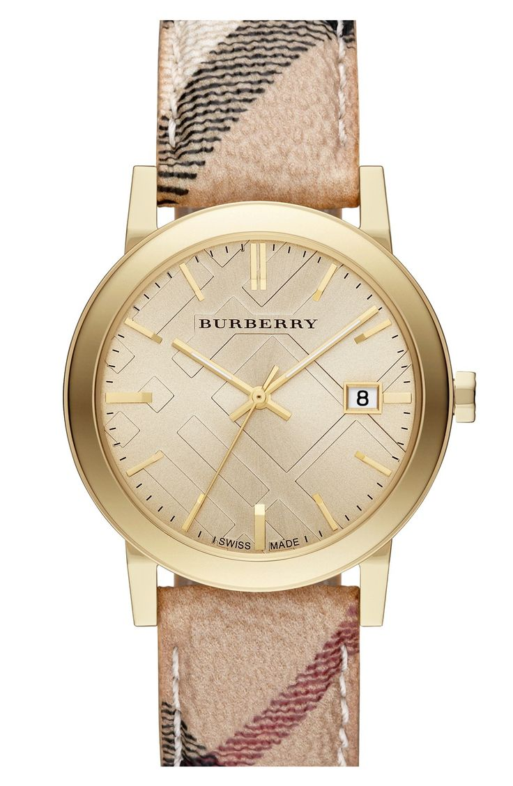 This Burberry check watch with gold details is so chic.