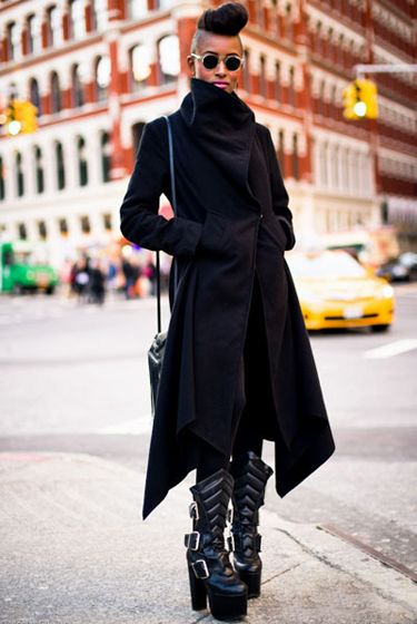 http://nymag.com/daily/fashion/2011/11/slideshow-the-week-in-style-blogs.html#photo=2x00032  Love the coat and sunglasses.  Hate the KISS boots and hair.  But she works that hair so that's all that matters, really.