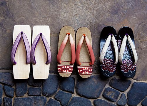 Geta are traditional Japanese footwear that resemble both clogs and flip-flops. They are a kind of sandal with an elevated wooden base held onto the foot with a fabric thong to keep the foot well above the ground. Geta are worn with traditional Japanese clothing such as kimono or yukata, but also with Western clothing during the summer months.