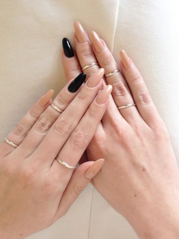 Nude nails with black nail accent  This is the only occasion I've seen that I like the pointed nails, I think th nude color just adds on to the creepy & it works...
