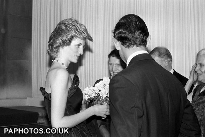The Princess of Wales in a strapless black gown, designed by Elizabeth Emanuel, with the Prince of Wales at the British Museum, when they opened the Wolfson Galleries of Classical Sculpture and Inscriptions. 1985