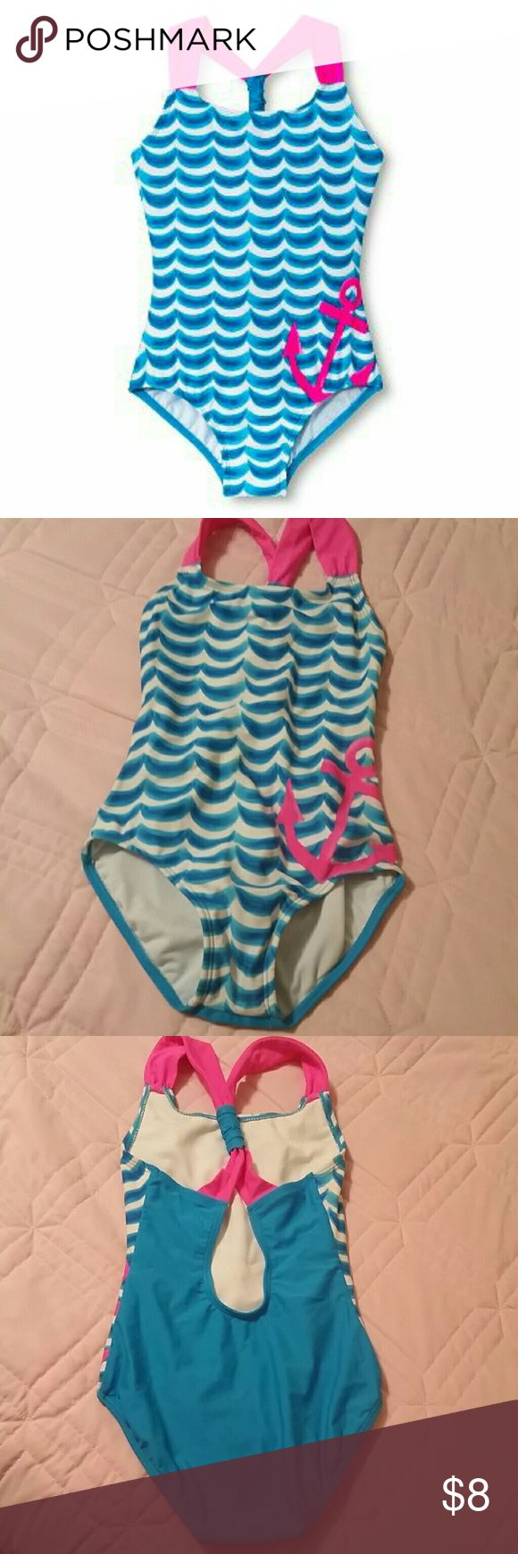 Xhiliration girl's one piece swim suit anchor pink Criss cross back 1 piece swim suit. Blue and white front with hot pink straps and anchor. Blue back. Xhilaration Swim One Piece