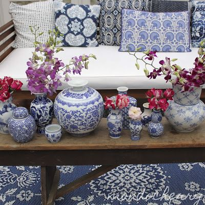 A small bite of mondocherry: classic blue and white... I love her choice of cushions on the day bed!