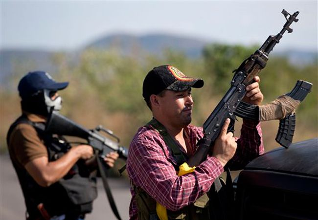 Militants, fighting the narcos