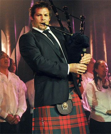 This picture just liquified my bones! WOW....  All Blacks Captain Richie McCaw playing the bagpipes and wearing a kilt!