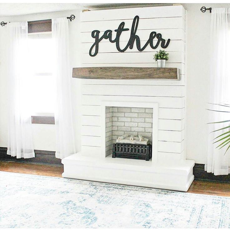 Shiplap fireplace focal point in white chalk paint with reclaimed wood mantle. Farmhouse. Trend. Interior decorating. Home decor. Home styling