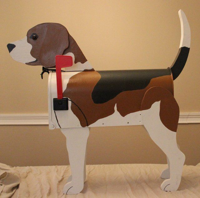 To collect your mail, a beagle built around a mailbox. I need to do this to ours.