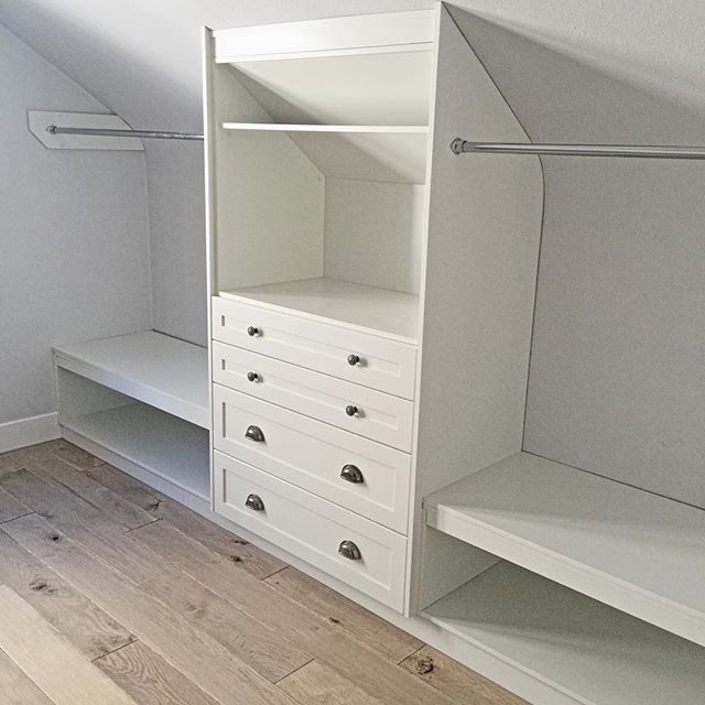 @delton_cabinets #customcabinetry! This older home has a wonderful sloped ceilings in the upper bedrooms. #dressingroom #tvcabinet #whiteoakfloors #whitecabinets #yegdesign #yeginteriors