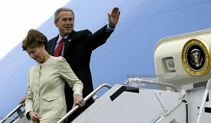 US President George W. Bush and First Lady Laura Bush arrive 25 June, 2004, at Ireland's Shannon Airport. Bush arrived in Ireland to take part in a weekend summit between the United States and the European Union.  AFP Photo/Tim SLOAN  (Photo credit should read TIM SLOAN/AFP/Getty Images)