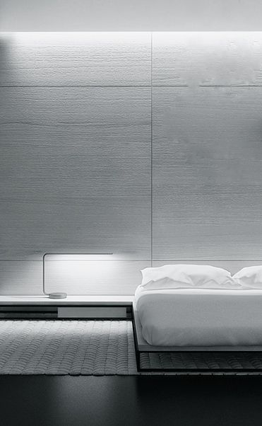 Soft lighting and a mix of flat surfaces and rounded 3D rectangles.