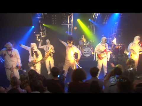 Here Come the Mummies.  Yeah, that's really the name of their group.  Here they dress up like mummies but they've got quite the sound and beat, love the singer's voice and the brass instruments.