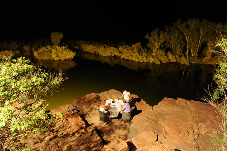 Remote moonlit dining over Chamberlain Gorge at El Questro Homestead.