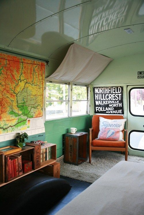 old school bus turned into traveling cabin (love the curtains, wonder if they're magnetic?!)