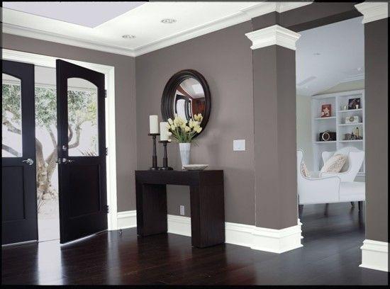 Dark wood. Gray walls. White trim.